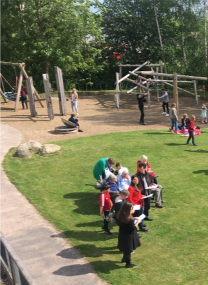 people in front of play area